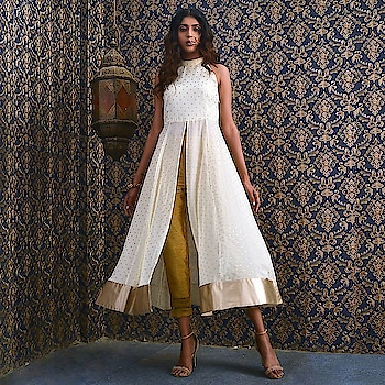 Add some swirl to your wardrobe with this gorgeous Ivory Dotted Foil Halter Neck Maxi Tunic! Get FLAT 40% OFF on your favourite ethnic styles! SHOP NOW  : https://goo.gl/Lg1yzN  #ropo-good #ropo-style #indowesternlook #ethnicwearonline #kurtisforwomen #indya #super