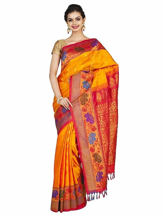 Golden yellow gadwal paithani with lotus border. #Classic #Beauty #Bride #Elegantbride #Indianhandlooms #IncredibleIndia #Paithani #Handloomsilk #Womenwear #Sareelove #Desifashion