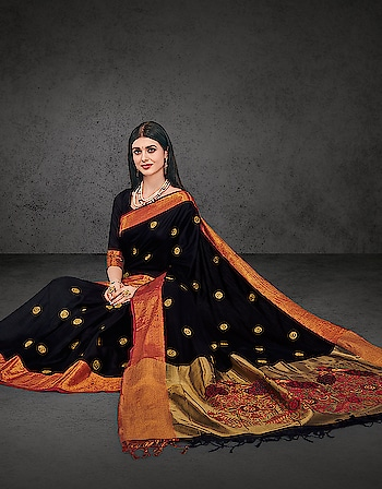 Nothing can exude elegance as this embroidered onyx black drape. The needlework on the pallu and the shimmering red border enchants the complete appearance.   Shop now: http://bit.ly/2noZ621  #saree-in-new #embroidered #handloom #weaving #cotton #cottonsaree #cottonsarees #sari #designer-saree #designer-saree #combo-sarees #wedding-saree