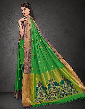 The gentle circles embroidered on the drape make a flawless balance with the rich pattern embellished on the pallu and styles a perfect outfit.   Buy now >> http://bit.ly/2noZ621  #saree #greensaree #embroidery #greenemerald #designer-saree #aurasarees #sareelover #sariwedding #saristyles