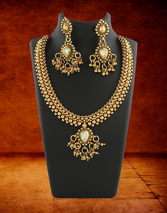 Look absolutely gorgeous by wearing this gold tone amazing Kundan necklace set with your matching attires. It is wonderfully woven with golden beads and studded with Kundan. This Kundan necklace set is made from Metal and has hanging droplets for added attraction. Excellent quality and high durability are the hallmarks of this set. So buy it Now by Clicking on the Link: https://goo.gl/hsSFnL  #kundannecklace #kundanearrings #anuradhaartjewellery #shopkundannecklaceonline #goldpatedkundannecklace
