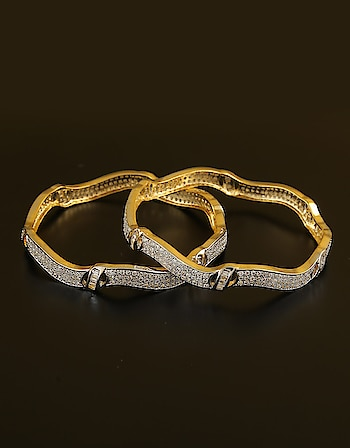 Adorn your wrist by clubbing this pair of designer bangles with your party costume. They are embedded with precious American diamonds and made from golden polished metal. These bangles are superior in quality and will be your fashion companion for many years. To Order this product Click on the link: https://goo.gl/7qy5p6  #buylatestamericandiamondbangles #americandiamodbangles #banglesonline #chudiya #diamondbangles #adbangles #banglebracelet #diamondkangan #kangan #diamondchudiyan #jewellery #americandiamondkangan #americandiamondchudiya  #wednesdaymotivation