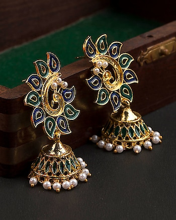 Elevate your style quotient with this pair of gorgeous peacock jhumka earrings from our Bella Collection.   https://navrang.voylla.com/products/gorgeous-bella-gold-plated-peacock-jhumka-earrings For more: https://navrang.voylla.com  #peacock #peacockcollection #peacockdesign #earrrings #earringsoftheday #earringswag #jhumkas #trendy-jhumkas #jhumkalove #peacockjewelry #peacockearring #goldenearrings #bella #goldplated #goldplatedjewelry