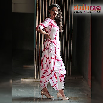 Make a style statement with this cotton viscose cowl kurta. The kurta features a beautifully draped one sided cowl, with a geometric tie and dyed look. Team it up with slim fit pants or wear it as a dress with silver hoops and loafers for a chic casual look.  https://bit.ly/2xo9BYR  #9rasa #studiorasa #bold #cowl #kurtas #blockprint #tiedye #tassels #jewelry #ethnic #contemporary #fashion #like #comment #share #followus #like4like #likeforcomment #like4comment #festival #blue #pink #black