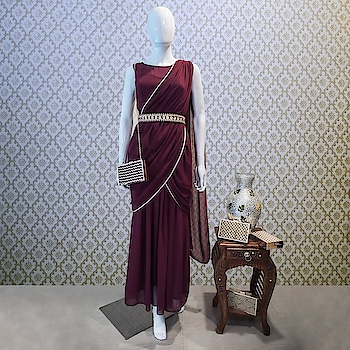 A contemporary piece with relaxed drapes and structured layers, beautifully tailored for a seamless fit, this Wine Sari Drape Tunic is a festive highlight from our fall collection. Shop Here: https://goo.gl/TUwnEE  #fashion #lookbook #womenwear #ethnic #bestdeals #buy #outfit #fashionupdate #ootd #wiw #bestdresses #bespoke #bridesmaids #bride #wedding #sangeet #asianbride #indianwedding #marraige   #indianwear #festivecollection #indian-festival #diwalishopping