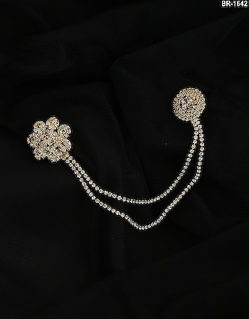 Be in spot light in your every occasion by wearing this dazzling Brooch with your favourite costume. To see more design click on this link: http://bit.ly/2x3NmHK #brooch #broochonline #coatbrooch #broach #americandiamondbrooch #flowerbrooch #pearlbrooch #fashionbroochpin #broochpin #lapelpins #largebroochpin #modernbrooch #fashionjewellery #latestbroochdesigns #fashionbrooch
