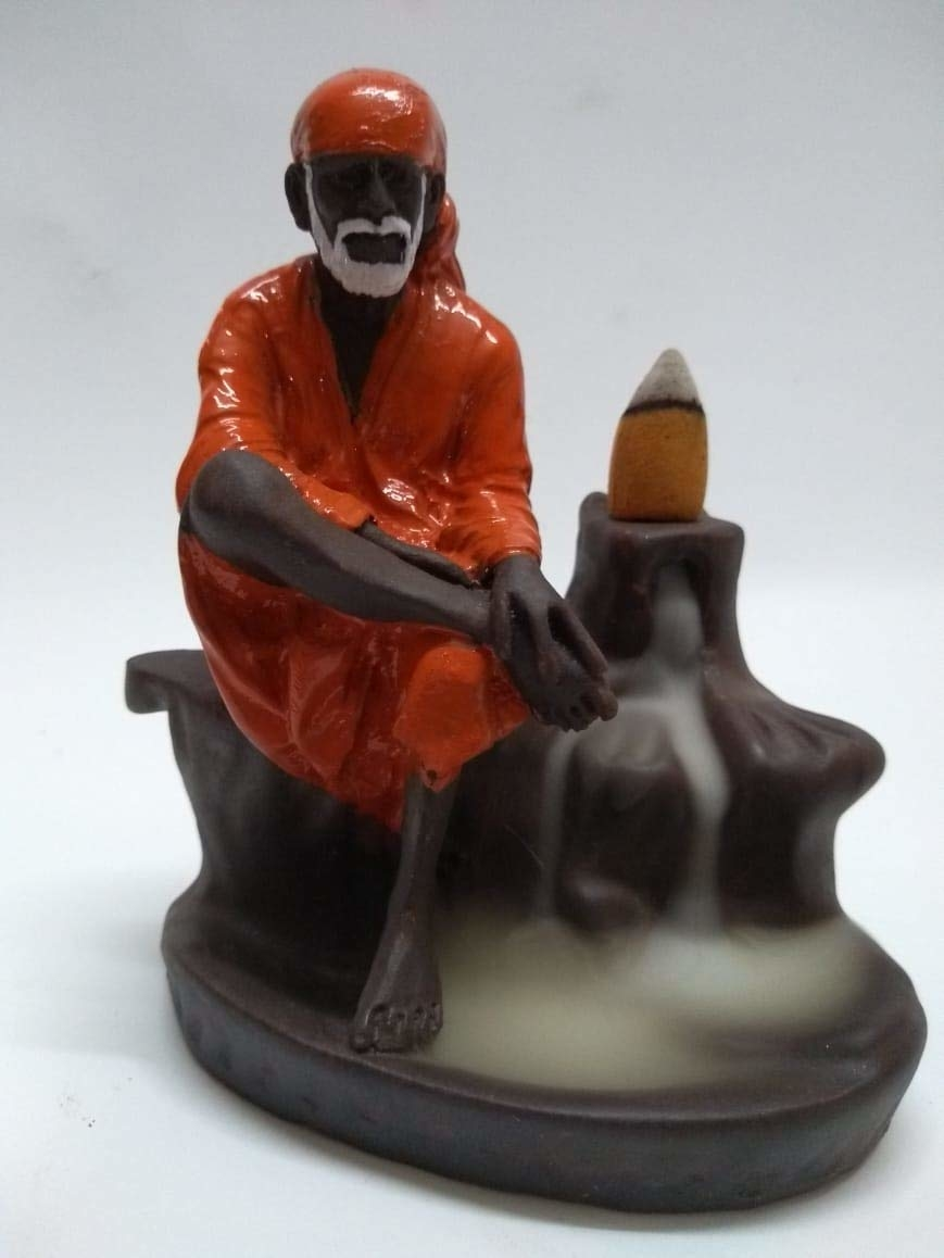 PCM BIOTECH Backflow Incense Burner Lord Sai Baba Incense Burner with Free 10 Backflow Cones (Red)    Package contents: - 1 Backflow Incense Holder with 10 Scented Backflow Cone Incenses Product dimension in cm (L*B*H) :- 8 x 8 x 12, material :- ceramic Care instructions :-gentle wash, use dry/wet cotton cloth to remove dirt We have also add a vassle from which the cone will not directly heat the outer material of the products, the cones will heat the vassle and prevent the affect to caused the outer material. Incense burners are ideal for burning your favorite incenses while providing a decorative accent to any space. Suitable for the study, bedroom, yoga studio. Place them on your desk, table, or ideally, on an alter stand  Buy Now :- https://amzn.to/2UNPBbE
