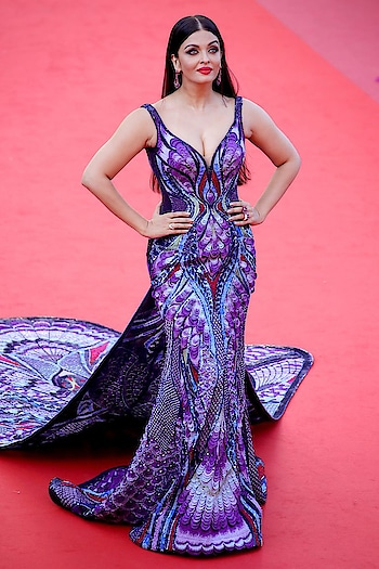 """Aishwarya Rai's Butterfly Dress at Cannes Took 3,000 Hours To Make  The Dubai-based designer dress completely covered in Swarovski crystals and French palettes; it consists of ultra-violet, midnight blue, and red thread works; and it boasts a 20-foot train that mimics """"a butterfly emerging from it's chrysalis."""" Plus, its body-hugging silhouette and sweetheart neckline compliment Bachchan's figure perfectly  #aishwaryaraibachchan #fashion #be-fashionable #fashionqueen #lookgoodfeelgood #lookgoodfeelgoodchannel #fashionquotient #fashionquotientchannel #followmeonroposo"""