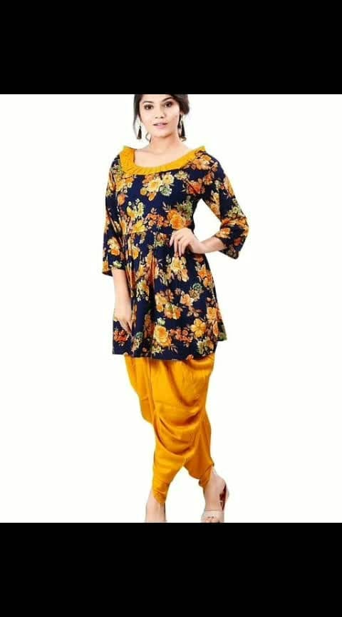 Hiba Graceful Elite Rayon Women's Kurta Set Vol 1  Fabric: Rayon Sleeves: 3/4th Sleeves Are Included Size: Kurti -M- 38 in, L - 40 in, XL - 42 in, XXL - 44 in, Dhoti - Up To 28 in To 36 in (Free Size) Length: Kurti - Up To 32 in, Dhoti - Up To 38 in Type: Stitched Description: It Has 1 Piece Of Kurti With Dhoti  Work: Printed / Striped  Dispatch: 2 - 3 Days