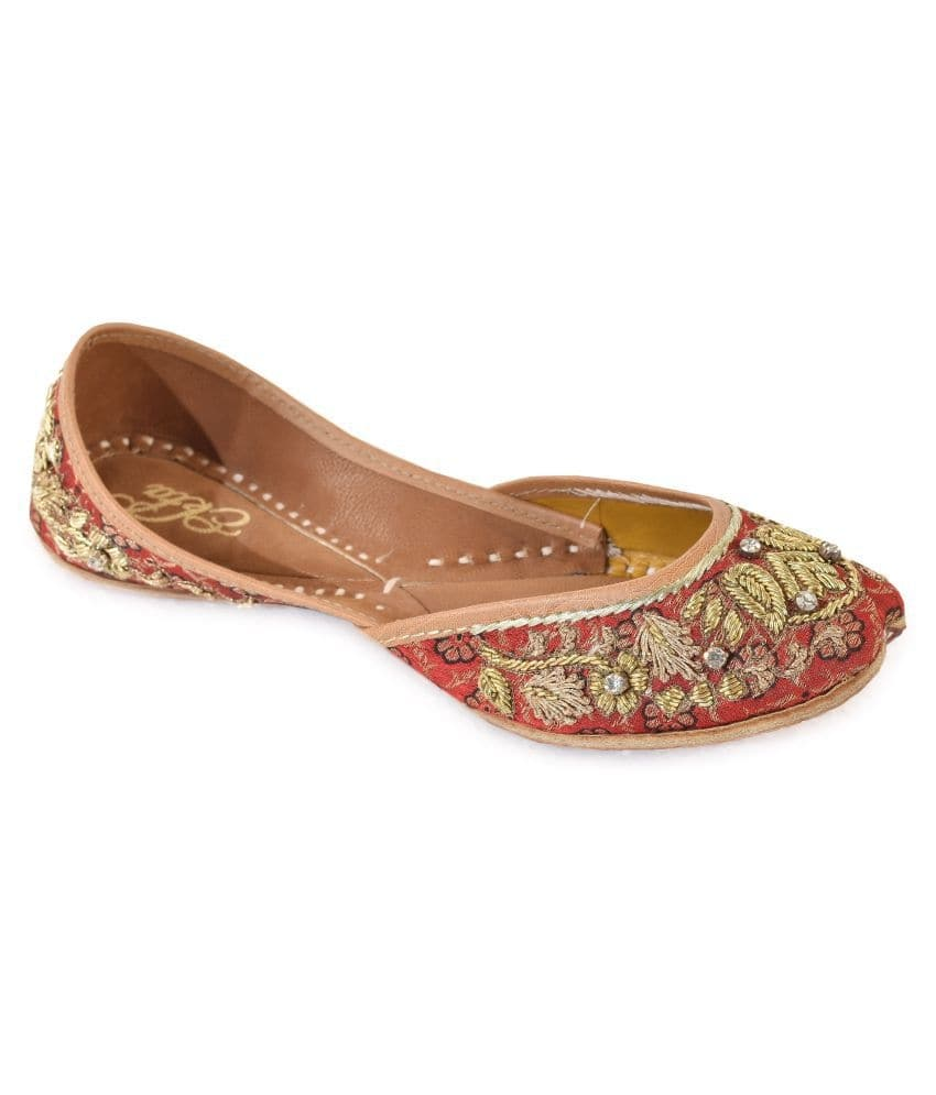 Red Slip On Jutis Brand: EKTA  product description : these red dulhan juttis are made of genuine leather & brocade and embellished with zardosi work & stone.\n the provided juti is designed by making use of finest quality leather and handloom material under the direction of our skilled professionals. these handmade juttis feature traditional embroidery on the body. this ethnic punjabi jutti and mojaris are very popular because you can wear theses juttis and mojaris in every dress formal as well casual, western as well as traditional. this is totally handmade with high quality leather. these juttis normally go with ethnic wear like, patiala suit, kurta pajama's and punjabi dresses, apart from these juties can also be worn with denims. most of the girls these days go with this footwear collection as it is not only completes the attire but makes them feel stylish as well.   BUY NOW- https://bit.ly/2EMWrbY