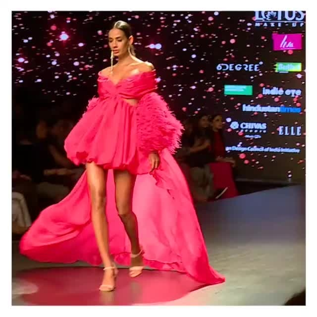 Hot pink statement gown with feather sleeves by #DollyJStudio at #FDCI #LMIFW Autumn Winter '19