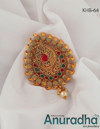 Designer golden finish enticing hair brooch studded with sparkling red-green colour stones from Anuradha Art Jewellery. To see more appealing designs click on the link: https://bit.ly/2OcgBxR #brooch  #hairbrooch  #newbrooch  #onlinebrooch #nashik  #maharashtra  #womensjewellery  #womensfashion  #highjewelry  #lukachuppi  #doubledhamal