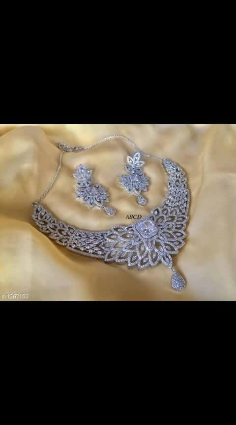 Jaunty Elegant Stylish American Diamond Necklace Set Vol 2  Material: American Diamond Size: Free Size Description: It Has 1 Piece of Necklace With 1 Pair Of Earrings Work: Stone Work Dispatch: 2 – 3 Days