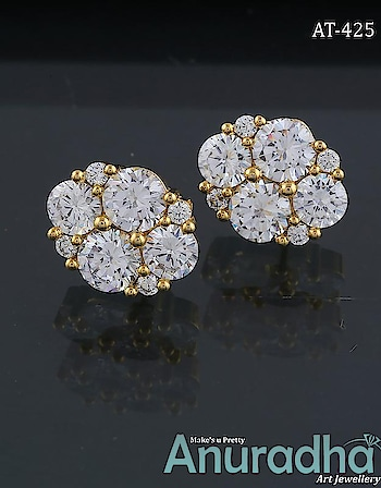 Silver-golden finish stylish pair of ear studs decked with precious American diamonds from the house of Anuradha Art Jewellery. To see more appealing designs click on the link: https://bit.ly/2ExToDo #earstud  #diamondearstud  #americandiamondearstud #onlineearstud #jewelry  #fashion  #womensjewellery  #womensfashion  #bharatbolemodimodi #worldautismawarenessday