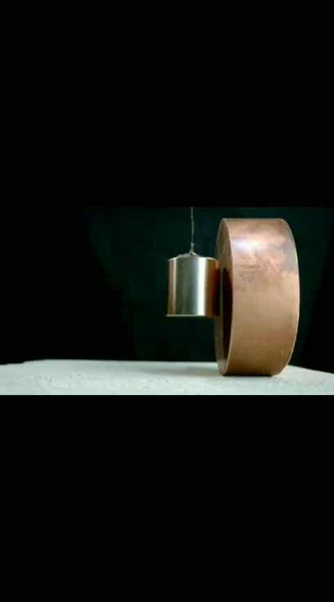 Copper's Surprising Reaction to Strong Magnets.  The copper itself is not magnetic, but when its approached by magnets, the electrons on the surface of the copper being rotating. In an effort to resist the magnet's pull, the electrons briefly create their own magnetic field, which slows down the magnet's descent. Copper is a soft, malleable, and ductile metal with very high thermal and electrical conductivity. A freshly exposed surface of pure copper has a pinkish-orange color. Copper is one of the few metals that can occur in nature in a directly usable metallic form (native metals). . Follow @sciencesetfree to learn new amazing stuff everyday. . Credits :- @nighthawkinlight . Source :- YT | NightHawkInLight #copper #magnet #interesting #technology #neodymium #worldofengineering #Experiment #chemistry #talkwidtech #art #engineering #amazing #geek #ellipsoid #conicsections #tippetop #physics #physicstoy #flip #flipover #precession #spin #spinning #top #science #scienceisawesome