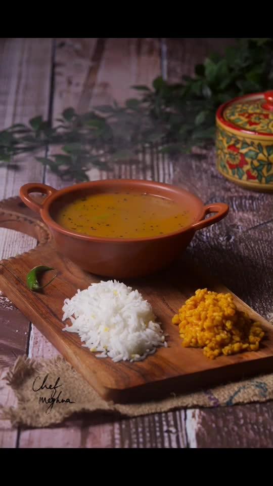 ફજેતો - फजेतो - FAJETO  (Gujarati Jain Recipe for Mango Season) Don't throw away mango skin & seed. You can make Fajeto from the pulp leftover on the mango skin & seed. Enjoy this Jain Special Fajeto, Mung Daal and Rice this Summer Season. Sharing the simplest recipe on chefmeghna.com Ingredients: 4 Ripe mangoes' left over skin and seeds Oil / Ghee Asafetida (Hing) Cumin seeds Mustard seeds Kadi patta (curry leaves) Turmeric powder ( Haldi) Chilie Powder Sugar and Salt per taste Pre-soaked Mung Daal  Method: Take left over of 4 ripe mangoes. After you take out mango pulp for aam ras (mango juice),  you are left with the skin and the seed of mango. Fajeto is made from the pulp leftover off the mango skin and seeds. Squeeze out the remaining mango pulp from the mango skin and the seeds into 2 cups of water. You will get thick mango pulp flavored water. Keep this water aside.  For Tadka,  In a pan, Take 2 tsp oil or ghee add 1/2 tsp cumin seeds and some mustard seeds add a pinch of asafetida Once the mustard seeds & cumin seeds crackle, add kadi patta (Curry leaves) Now add 1/4 tsp turmeric powder (haldi) & 1 tsp chili powder Salt as per taste.  Now add the mango flavored thick water (kept aside earlier) add 2 tsp sugar (as per your taste) Bring it to boil Fajeto is ready; it's usually watery consistency (like Rasam). Sometimes Fajeto can also be made with Curd & Chickpea flour, but it's a different recipe.  You can enjoy Fajeto with rice and dry mung daal.  To make Mung Daal, Cook pre-soaked mung daal with very little water, salt & turmeric powder (haldi). Bring it to boil. Keep taking out the white color froth that keeps coming out of mung daal. Cook till it's almost done.  For Tadka on daal - take oil, add asafoetida & red chili powder. Add this tadka on top of Mung Daal & cook till daal gets cooked properly. Love M  . . . #ChefMeghna #fajeto #jainfood #jainfoodgasm #vegetarian #mango #summer #recipes #traditional #indianfood #indianfoodbloggers #indianfoodblogger #