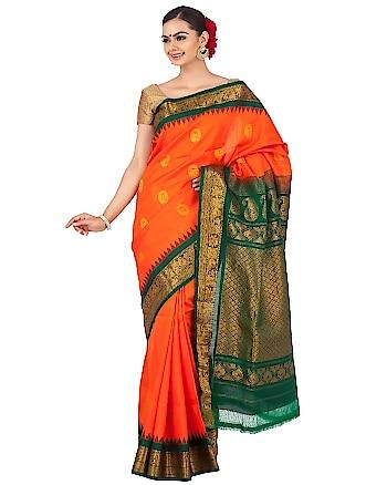 Orange gadwal saree with green border. Shop now at http://bit.ly/2vWQZyj #ethnic #ethnicwear #traditionalwear #traditionalsaree #ethnicsaree #gadwalsaree #wedding #weddingsaree #bridal #bridalsaree #onlineshopping