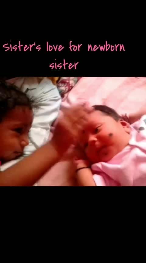 sister's love for newborn sister