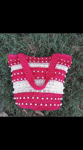 """Pink and white Handmade Crochet Bag👇. . 👉Type - Silk Thread. 👉Height - 8"""" . 👉Width - 11"""". whatsapp me 9811764074 for price details and more. .👏👏👏. #crochetbags #handmadecrochet #crochet #bagpattern #shoponline #handmade #crochetlovers #morningclick #productphotography #instaproducts #picofheday #instareview @crochetpage  @handmade_crochet_bag"""