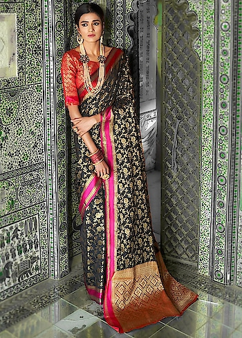 Brighten up your wardrobe with this beautiful Black Partywear Saree.This gorgeous saree comes with Ganga Jamna silk border and Handloom Weaving Silk Blouse