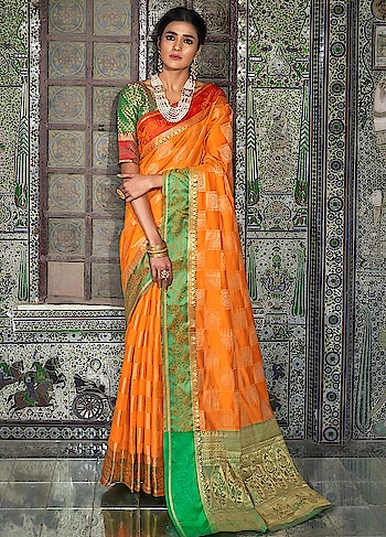 Brighten up your wardrobe with this beautiful Orange Partywear Saree.This gorgeous saree comes with Ganga Jamna silk border and Handloom Weaving Silk Blouse