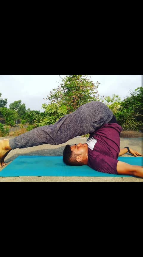 🤸Plough Pose, Halasana 🤸  It is derived from the Sanskrit word 'hala' which means 'plough'. It is named so because the final pose resembles the plough, an agricultural equipment. *STEPS*:- 1.Lying on the floor in a supine position, with the arms alongside the body and palms facing down.  2.bend the knees and kick and keep the legs up .  3.now also strengthen your back and lift along with the leg. Repeat this 3- 4 times.  4.once you confident enough in  lifting your back along with legs. Try to bend  your leg opposite side and try to tpuch to surface.  5.once you confidence to touch surface Keep your knees straight and try to hold on with slow breath in/out.  Benefits:- 1.Improves the tone and strength of back muscles and spinal cord as the back is folded, as well as the leg and abdominal muscles.  2.Improves the working of the spinal nerves by creating pressure on the nerves in the neck region which are normally sympathetic,  3.Increases blood circulation  4.Muscles ligaments of thighs and calves gets relaxed and stretched  5.Increases flexibility and provides a feeling of relaxation during leg cramps  6.Makes spinal cord strong and flexible  7.Improves the digestive system, useful who are suffering from constipation and gastric problems  #mondaymotivation #yoga #halasana #yogadamneveryday #flexibilitychallenge #yogaforlife❤️ #istahealth #decathlonsportsindia #journeyfromfattofit  #fattoflexible #yogindia #ishayogacenter #sadhgurujaggivasudev #rebeccalouisefitness #elevatetogreat #indiavspak #pkmkb #pkmkbc #ambernathkarofficial #ambernathkarofficial #marathimulga #indianfitnessblogger #mumbaifitnessblogger #mumbaiblogger #mumbai #maharashtra