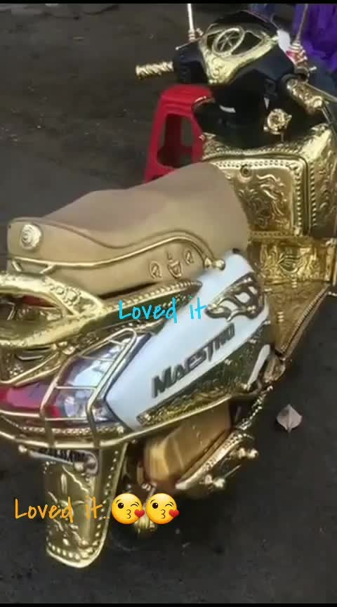 ##Roposo##Latest##modified##with gold##White coloured##maestro##scooty##