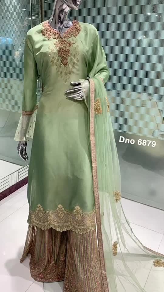 Rate:5250/-  Shirt Fabric: Upada Specification : Hand Embroidery with bell sleeves Duppta: Net dupatta with hand motifs Bottom : Embroidered Sharara Pants