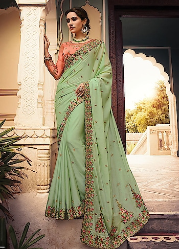 Flaunt In This Pastel Green Heavy Embroidered Silk Saree And Peach Blouse Totally makes a style statement   https://www.manndola.com/amazing-pastel-green-party-wear-saree