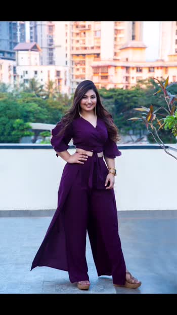 """MAJOR throwback to this quick shoot I did during our first movie promotion of """"Madhuri"""" as a Co-producer ☺️ (it was a Marathi film) ♥️ So the outfit was something I picked out from lokhandwala! And everyone loved it. It's such a beautiful tone of purple and it was perfect to wear during a day event. I paired up this coordinate with wedges I had bought long back from @jabongindia (I used to shop a lot from there like crazy earlier, lol)  Also wore a chunky bracelet and long earrings to put it all together 💫 Decided to get some soft curls done and I had highlights done back then so they looked lovely for a change 😁 and for the makeup I went in with a glam look with glossy lips and false eyelashes with winged liner 💄 Ps: keep supporting lovers ♥️ xoxo . . . #indianfashionblogger #mumbaifashionblogger #indianmua #fashiongram #purplelovers #coordinate #softglammakeup #styleoftheday #beautytips #fashiontips #curvywomen 🙌🏻"""