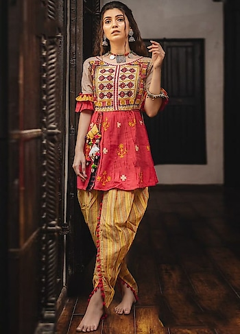 This colorful & Exciting new Kediya & tulip pant is perfect for Dandiya or Garba occasion. This Apparel features Heavily Embroidered Pure Khadi Top with matching Bottom.  https://www.manndola.com/inviting-red-yellow-kediya-tulip-pant