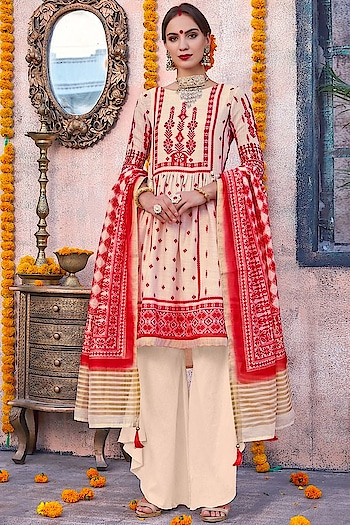 Bloom this season with Breathable Outfits, Glam up you look with this Dazzling Cream & Red Palazzo Style Suit. This Stunning Apparel features Digitally Printed Poly Linen Kameez with Dyed Cambric Cotton Bottom & Dyed Malamal inner. The Chanderi Dupatta of this dress will surely add Grace to the whole Dress.  https://www.manndola.com/dazzling-cream-red-palazzo-style-suit