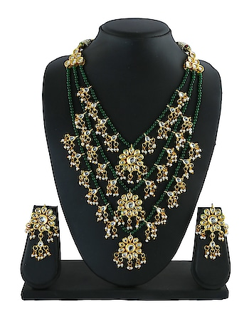 Fashionable Gold Finish Kundan Necklace Styled With Pearls Beads.  To see more collection click on the given link: http://bit.ly/30GDHmk - - - - - -   #kundannecklace #stylednecklace  #latestnecklace #goldfinishnecklace  #kundanjewellery #anuradhaartjewellery