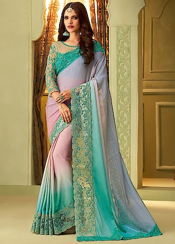 Avail This Turquoise Blue Eye Catching Saree For Your Next Occasion.This Saree Features Luxury Silk With Zari And Thread Work Along With Silk Blouse.  https://www.manndola.com/hot-turquoise-blue-party-wear-saree