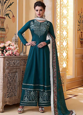 Make a Style Statement with this Outstanding Turquoise Blue Palazoo Style Suit Featuring Heavy Embroidered Muslin Top & Embroidered Santoon Bottom with Digitally Printed Pure Muslin Dupatta.  https://www.manndola.com/outstanding-turquoise-blue-party-wear-palazzo-style-suit