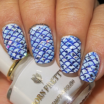 Hi everyone, Today I have Mermaid Nail Art for you. I created this with glitter, to see how I used them you can check my youtube tutorial.. link in bio😌 .  I used: . 💙Glitters From @daiso_singapore . . 💙Blue Stamping Polish from @beautybigbangs . . 💙White Stamping Polish from @bornprettystore . . 💙Stamping Plates BBBXL002 @beautybigbangnail . . 💙Silicone Stamper from @beautybigbangnail . . 💙Top coat from @bornprettyofficial . . .  🔅🔅🔅🔅🔅🔅🔅🔅🔅🔅🔅🔅🔅🔅🔅🔅🔅 🎁Use ISH10 for 10% off on https://www.beautybigbang.com/ 🔅🔅🔅🔅🔅🔅🔅🔅🔅🔅🔅🔅🔅🔅🔅🔅🔅 - - . 🎥 Full tutorial is up on my YouTube channel, link is in the bio👆 Go watch it, show some love ❤️ and don't forget to hit the Subscribe button 😌  #designyournailsbyisha #ishanailart #mermaidnailart #beautybigbangnailart #doublestamping #layeredstamping #glitternails #disneynailart #mermaidscalenails #summernailart #bbbxl002 #bornprettynails #naillacquer #nailartwow #nailpromote #nailsofig #nails2inspire #nailsofinstagram #nailart #nailstamping #stampingnailart @design_your_nails_by_isha💖
