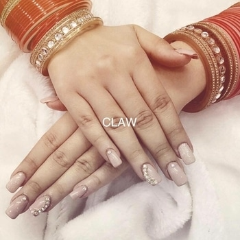 Nude shades will compliment any outfit and style 💅 and works perfect for warm days. Adding some extra romance with gold dust & swarovski stones 😍#manicure #claw #nails #happy #fresh #nudeshade  #goldnails #stylist #delhi #mumbai  #instadaily #inspiration #getclawed💅