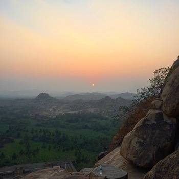 Throwback to a dreamy sunrise from Matanga Hill. Those hills in the foreground with huge boulders are the real beauty of Hampi !! Not that the ruins are not good. They are marvellous but these rocks, stones, boulders define the landscape and I am pretty sure you haven't seen anything like this before !! Not to mention all the mythology surrounding Hampi!! It's right up there in my list of favourite places in India to visit !! Pic credit goes to my better half, V 👫  #hampi #matanga #hill #climbing #landscape #surreal #sunrise #incredibledestinations #incredibleindia #natgeoyourshot #photography #travel #wanderlust #travelblogger #vistas #views #ancient #ruins #traveldiaries #travelgram #indiantravelblogger #mumbaitravelblogger #beautifuldestinations #instatravel #ropo-love #roposo-good #soroposo