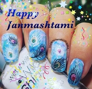 Happy Janmashtami🎉🎉🎉 #designyournailsbyisha #indiafestivalnails #ishanailart #nailfashion #janmashtaminailart #happyjanmashtami #peacockfeathernails #feathernails #smooshynails #nailblogger #bblogger #nailfun #nailporn #nailartist #partynails #festivalnails #indianfestivalnails #roposonails #roposoblogger #soroposo #roposofashion