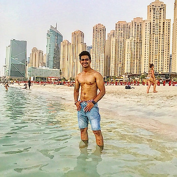 Welcome to JBR Beach 🏖💪🏻🏊🏼♂️ #beach #beachboy #beachlife #water #sea #arabian #arabiansea #gulf #swim #shorts #zara #jbr #model #fit #fitness #beachbody #leanmuscle #smile #happy #memories #roposo #gulf #dubai #dxb #dxblife #jumeirah #jumeirahbeach #uae #sajansinghrawat