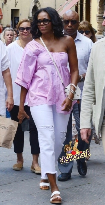 Michelle Obama street style look is on point for a holiday in Italy. #celebrityfashion #streetstylelook #summerfashion #international #streetstyle #michelleobama #fashionista