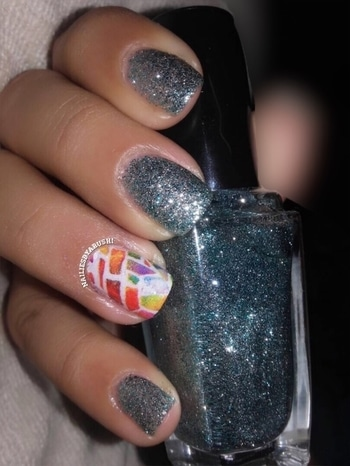 Another Great Pattern from @nailhugs 💚 Check out my previous post on how to apply them 💅🏻 I tried this pattern without a Base Polish since it is already opaque!! Alot of other patterns can be used with or without polish too💅🏻 THINGS TO KEEP IN MIND:- 💅🏻If using a base polish make sure it dries completely before you apply #nailhugs as it will not transfer on your nail and also will smudge the base polish !! 💅🏻be very careful while removing the cut out design from the protective base as being careless can ruin the design !!! PROS:- 💅🏻Easy to Apply 💅🏻Quick Application 💅🏻No Drying Time 💅🏻No Smudging  CONS:- 💅🏻Requires Patience as being careless & too quick will ruin the design !!! ( trust me i had my share of wastage ) These are available in various awesome designs on  www.nailhugs.com  Check out my #YouTube Channel for a detailed videoon how to apply them & hit the subscribe button !!! Link in bio ⬆️ This Gorgeous Turquoise Blue Glitter Polish is from @sally_hansen & its called #sallyhansenfantasea #fantasea #fantasea330  I tried this at a salon & i knew it right then that i am buying this !! Unfortunately it took my forever to find it & eventually when i did on @mynykaa it was out of stock so i waited for it to be back in stock & got it 😬 #nailhug #nailtutorial #drytransfer #drytransferdecal #nailstyle #classynails #simplenails #nailtutorial #pikreview @pikreview_official  #nailstagram  #nailpolish  #nails #blogger #nailbloggers #nailblog #blogpost #naildesigns #naildesign  #manicure #nailsoftheday  #nailpolishlover  #nailblogger #sallyhansen #blogs #nailbloggersofinstagram  #nailiesbyarushi 💚 #nailart