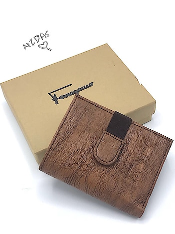"""*FERRAGAMO POCKET Wallets* _For Cards & Cash_ _Imported Quality_ With Brand Box Size:-4""""x3.5"""" *Price :- 545 only free ship/-* *Pick any 2@ 525 each free ship same address 🎉 🎉🎉 🎉* 😊rd"""