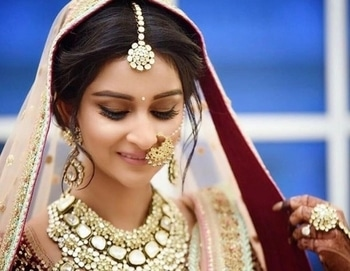 This bride steals our heart by her shy smile & graceful maang-tika.  Shop your bridal cosmetics & jewellery from WedLista.com.  Makeup by: @amritkaurartistry  #WedLista #FashionForWeddings