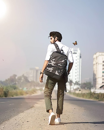 Moving on with all the essentials in one of the most stylish camo. backpack i have from @beinghumanclothing. . . Captured - @thedaydreamstudio . . Bagpack by - @beinghumanclothing . . Wearing - @kollars.for.mens . . Captured by - @thedaydreamstudio . . . #TSDFAMILY  #TSDFAM  #thestyledweller  #thestyledwellerxbeinghuman #olive #men #white #levitation #allwaylong #black #streetstyle #fashiontrend  #menshair  #menswithstyle #menwithstreetstyle  #chinos #shirt #mensfashionreview  #mensfashionpost  #mensstyling #menswear #fashioninfluencer  #fashionblogger  #indianinfluencer  #indianblogger  #contentcreator #surat #india