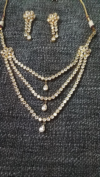 white stone stud necklace set with earring  rate 3000 plus shipping whatsapp 9162060671