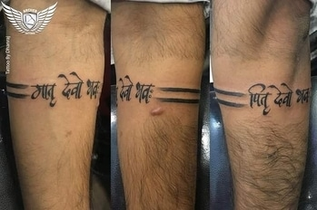Arm band with MATRU DEVO BHAVAH and PITRU DEVO BHAVAH.. client want some basic band and one more tattoo related to his parents here is the design we ended up #armbandtattoo #parentstattoo #maatattoo #paatattoo #maapaatattoo #matrudevobhavah #pitrudevobhavah #bandtattoo #bandtattooformen #blacktattoo #forearmtattoo #archertattoos #tattoobydhanrajthakkar #ahmedabadtattoo #tattooinahmedabad  for appointments call us on 90169 53197