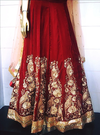 Red Bridal Wear heavy lehanga available at our designer store!  Heavy embellished with jari and sequences, red velvet lehanga along with peach net dupatta!  #Redvelvet #peachcolordupatta #heavyembellishedhandwork #jariwork #sangeetasharmadesignerstudio!