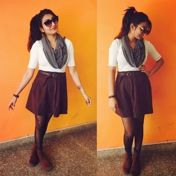 What i am wearing is white one forth sleeve top and pairing it with brown skirt.. tied the skirt with brown belt.. i choose grey scarf to enhance the look..  Below i am wearing black skinny stockings.. and brown boots to complete my look..  This complete look goes well together.. Hope you like it..   #mystylemantra