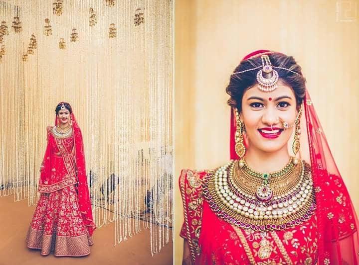 Absolute balance of cherry red lehenga with pearl and multi-hued Kundan jewellery!  Image Credit: poojajosephphotography  #WedLista #FashioForWeddings #cherryred #ethnicwearonline #bridalwear #loveforethnic #ropo-love